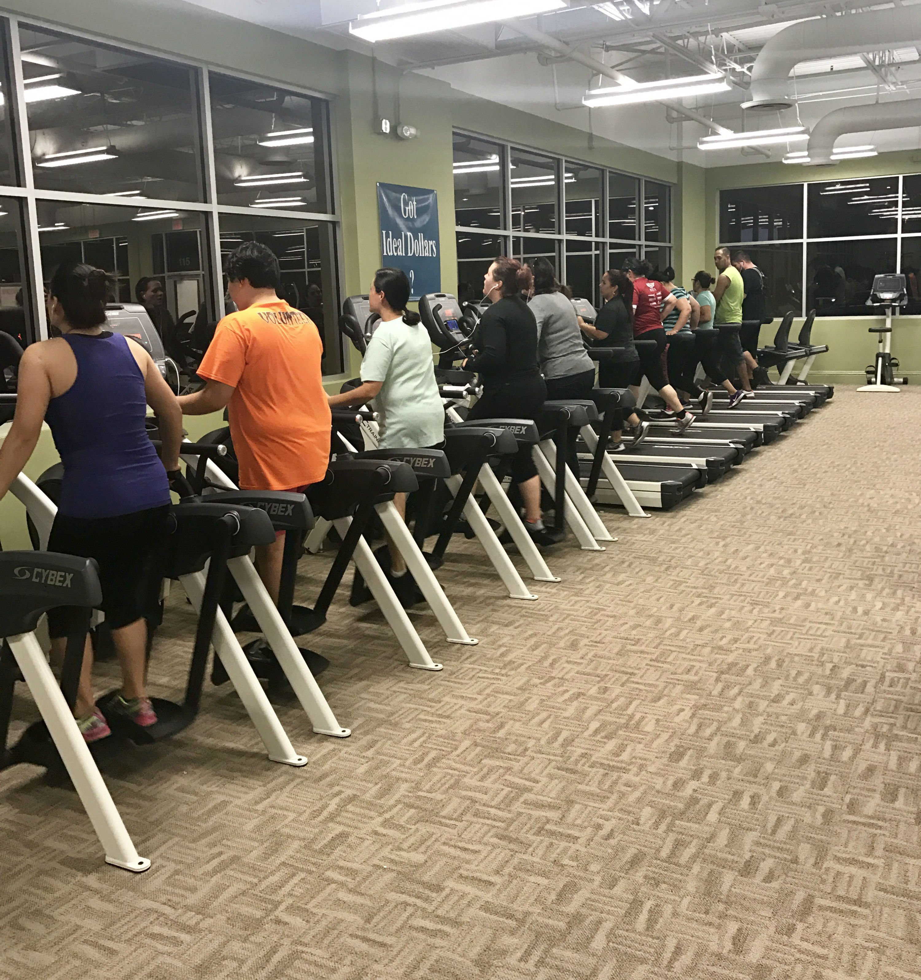 People using workout machines